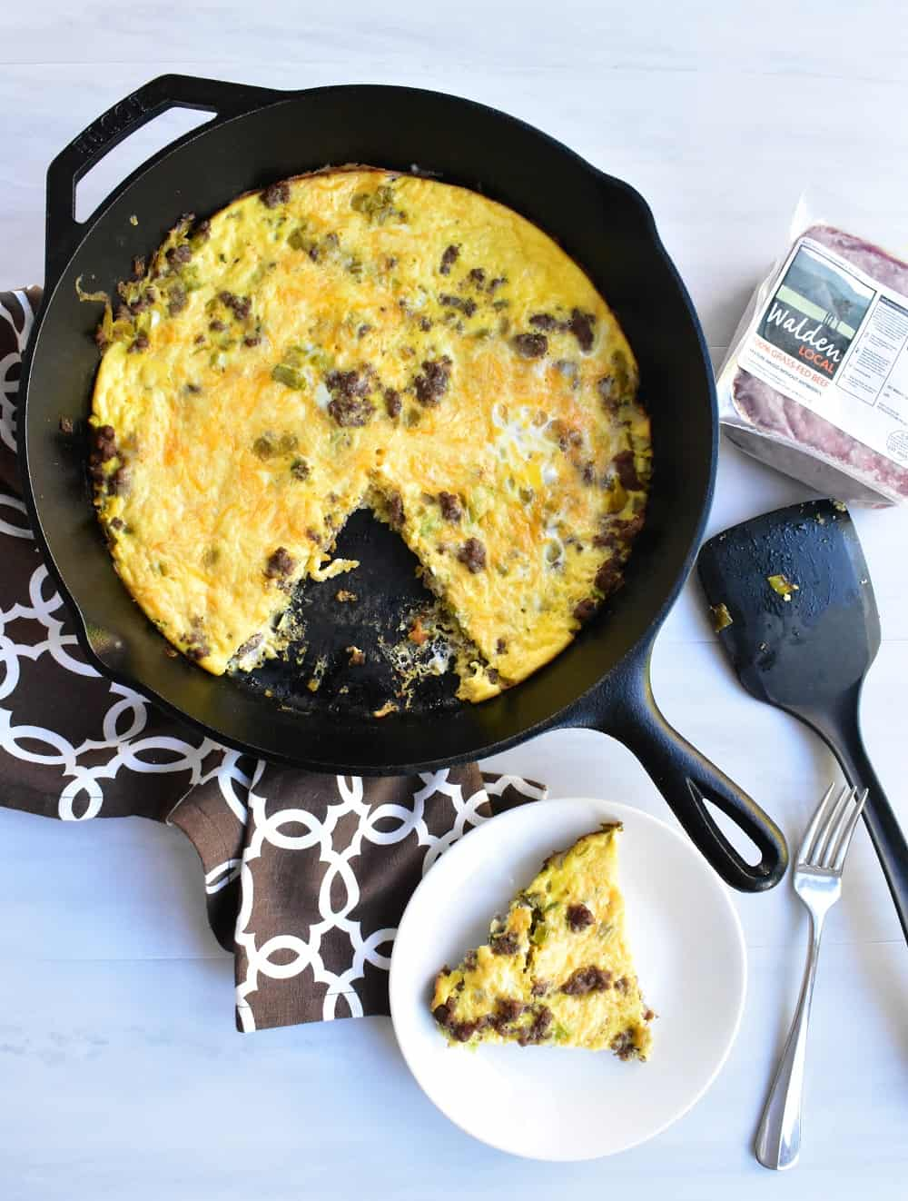Cheeseburger frittata on a plate and in a cast iron skillet