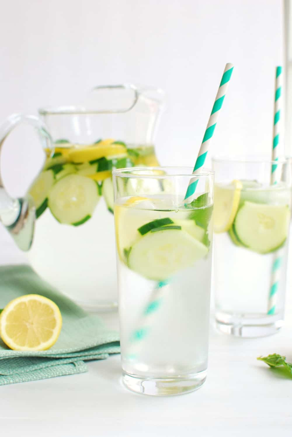 Glass full of infused cucumber lemon mint water