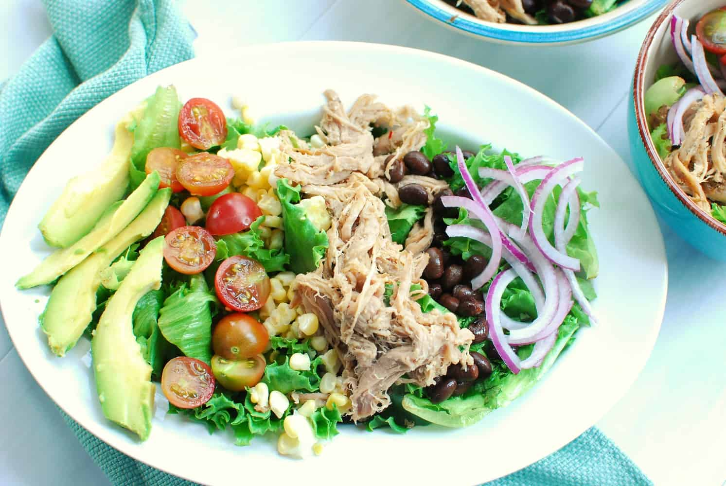 Bowl of carnitas salad with salsa verde dressing
