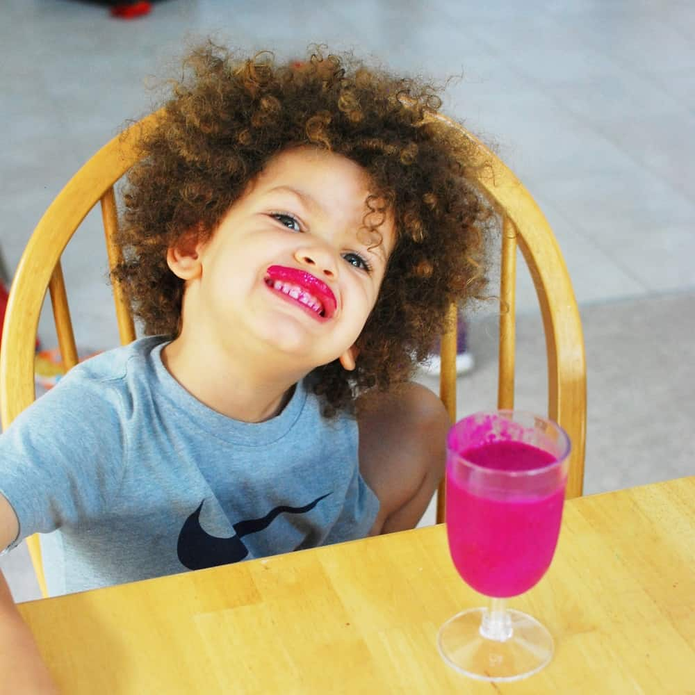 Child drinking dragon fruit smoothie