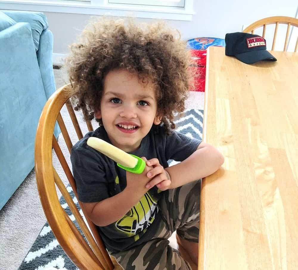 Child eating homemade pineapple popsicles