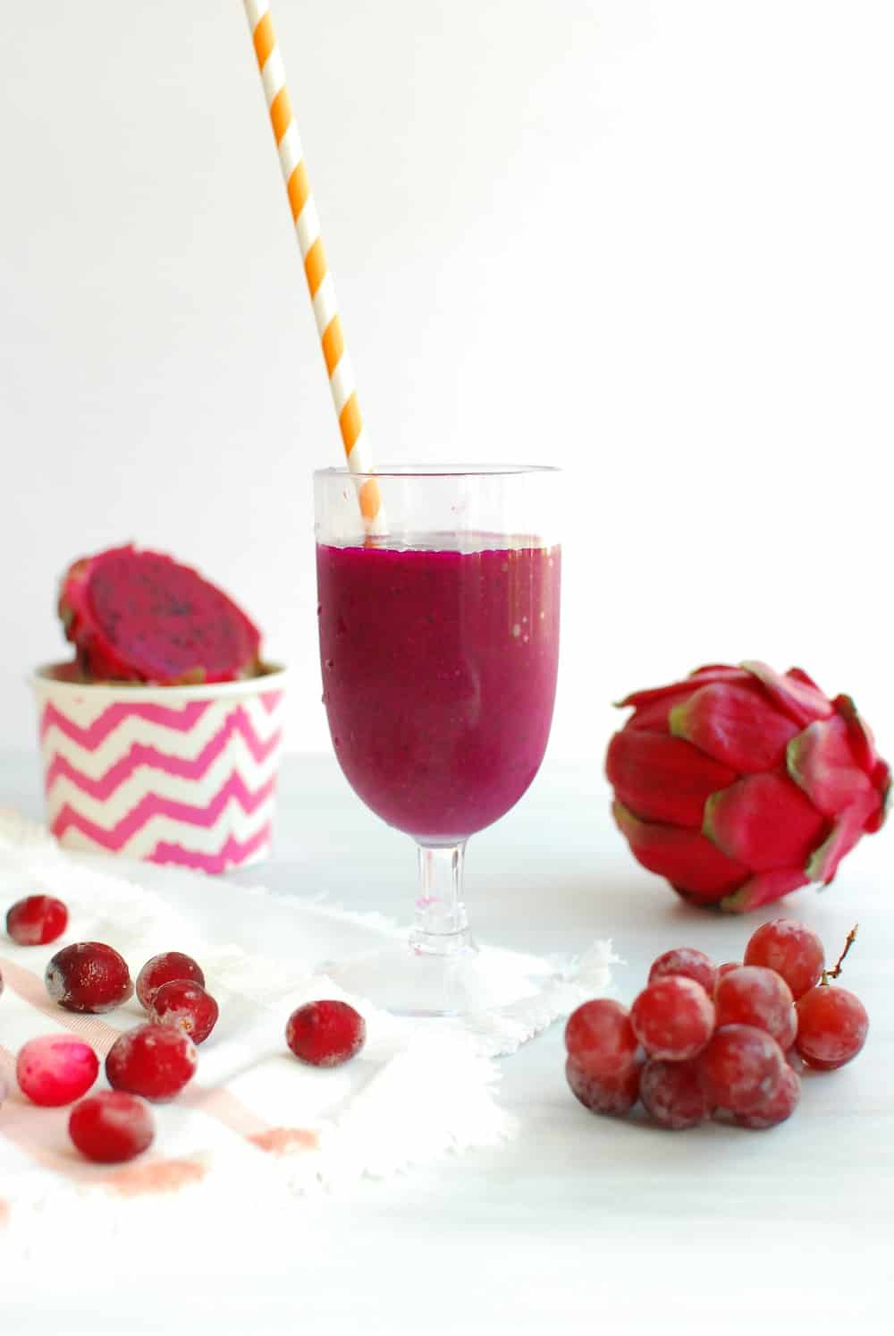Dragon fruit smoothie in a glass with a straw