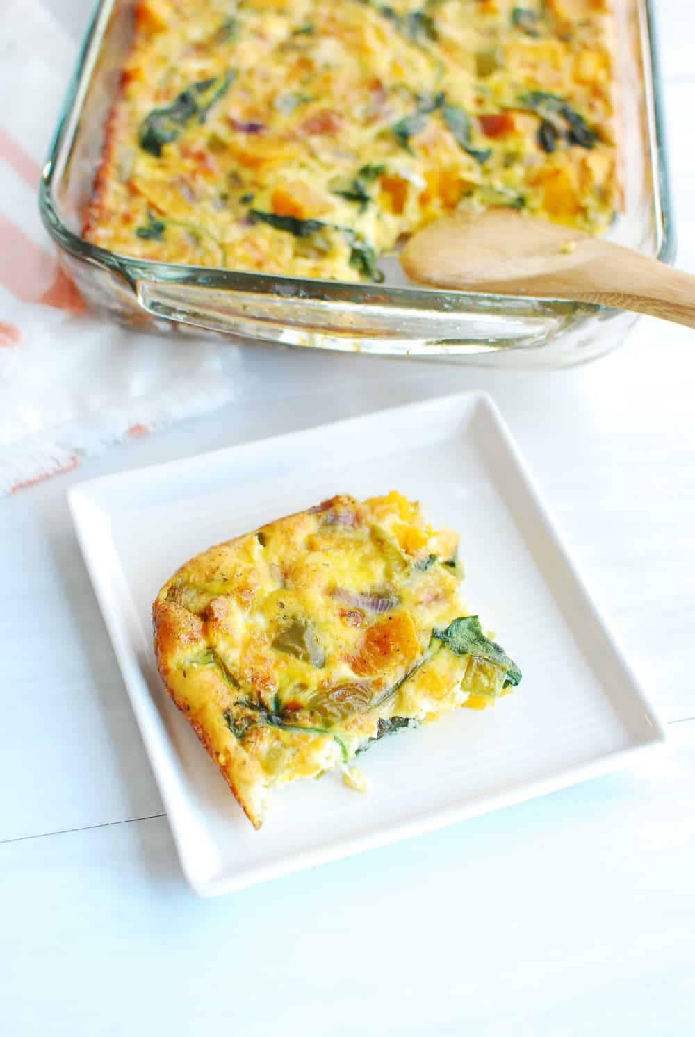 Slice of butternut squash frittata on a plate