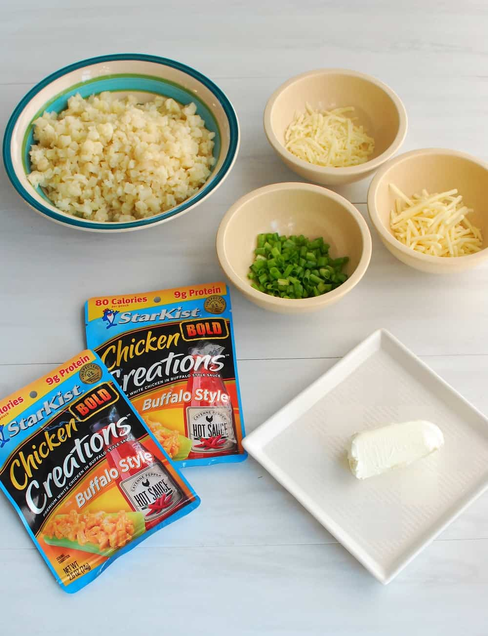 Ingredients to make a buffalo chicken cauliflower rice casserole