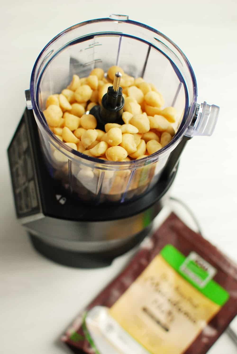 A food processor full of macadamia nuts