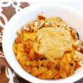 Sweet potato breakfast bowl next to a brown napkin
