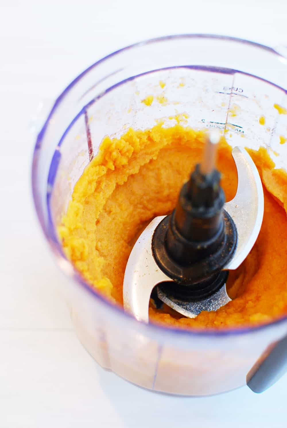 sweet potato in a food processor with cinnamon and almond milk