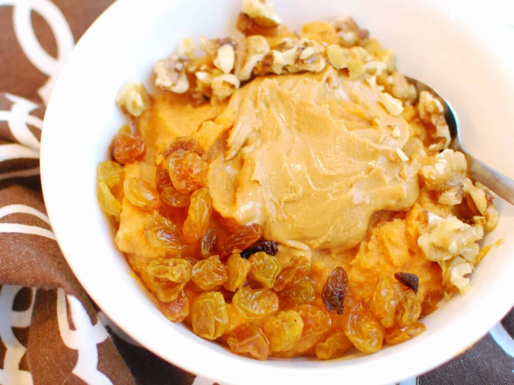 a white bowl filled with sweet potato breakfast bowl