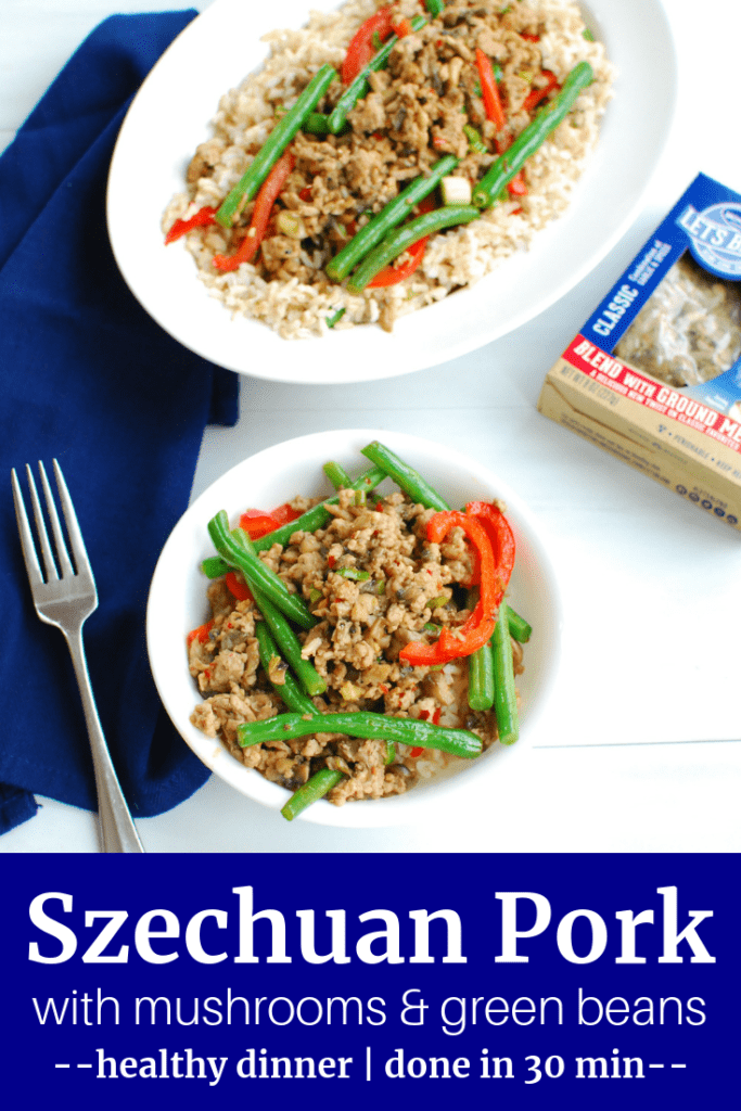 Two bowls full of Szechuan pork with mushrooms and green beans