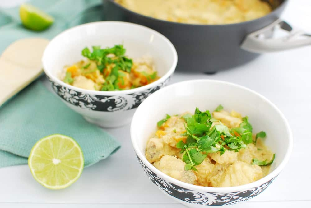 Two bowls of thai monkfish curry