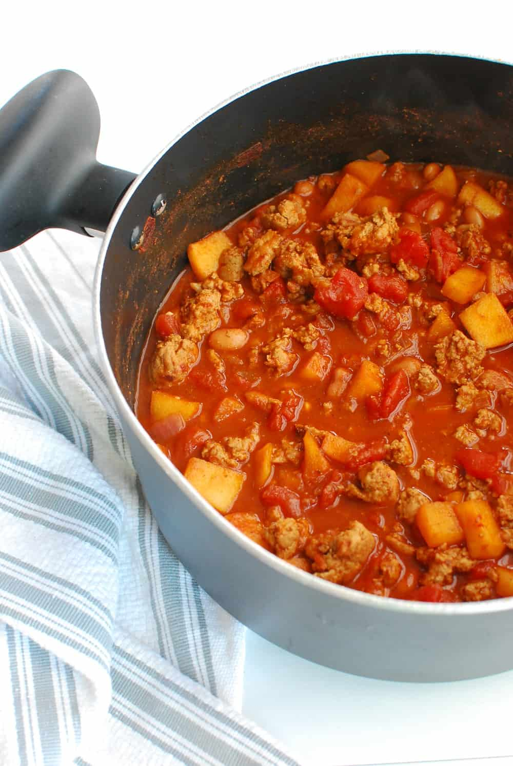 a large pot full of healthy turkey chili made with chipotles and apples