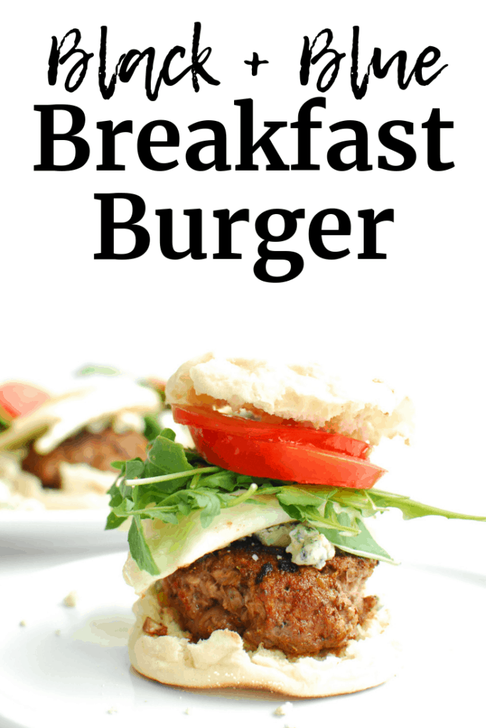 A breakfast black and blue burger served on an English muffin