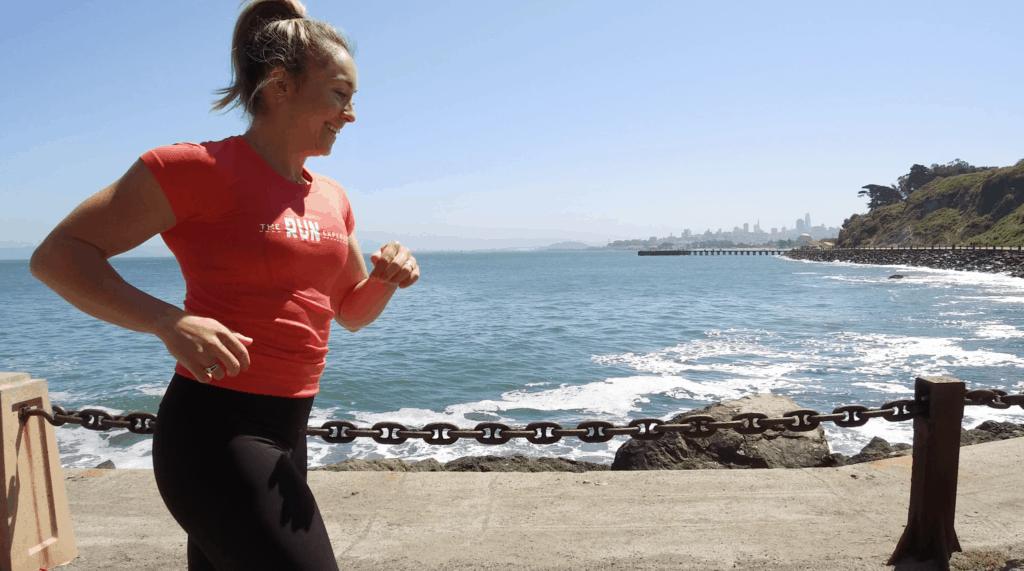 Holly Martin running alongisde the beach