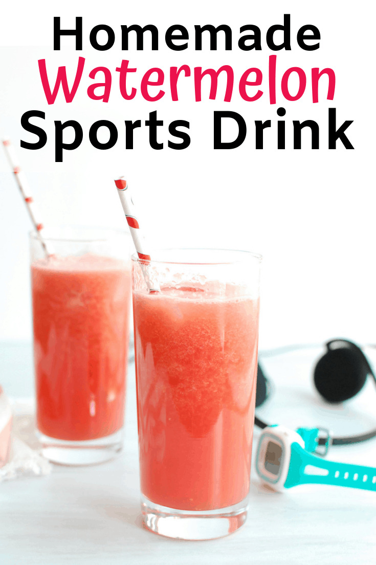 Two glasses filled with homemade sports drink next to a watch and headphones
