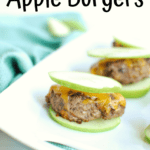 A mini apple burger on a white platter