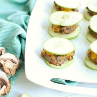 a white platter full of apple burgers