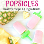 Three homemade popsicles next to a pineapple and yellow napkin