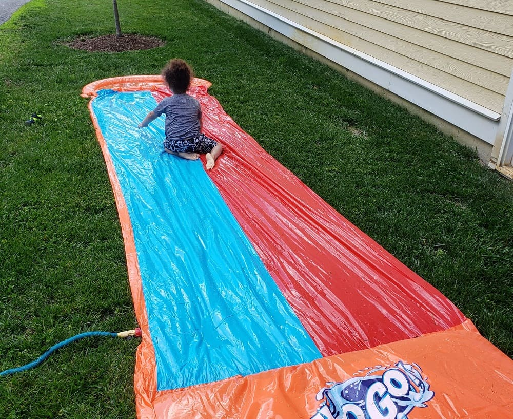A child on a slip and slide