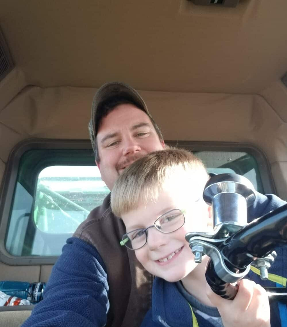 Potato farmer in Maine with his child