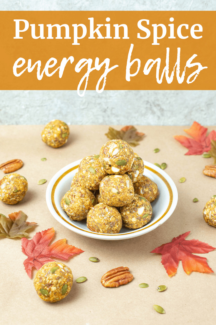 A with pumpkin energy balls next to some scattered leaves and nuts