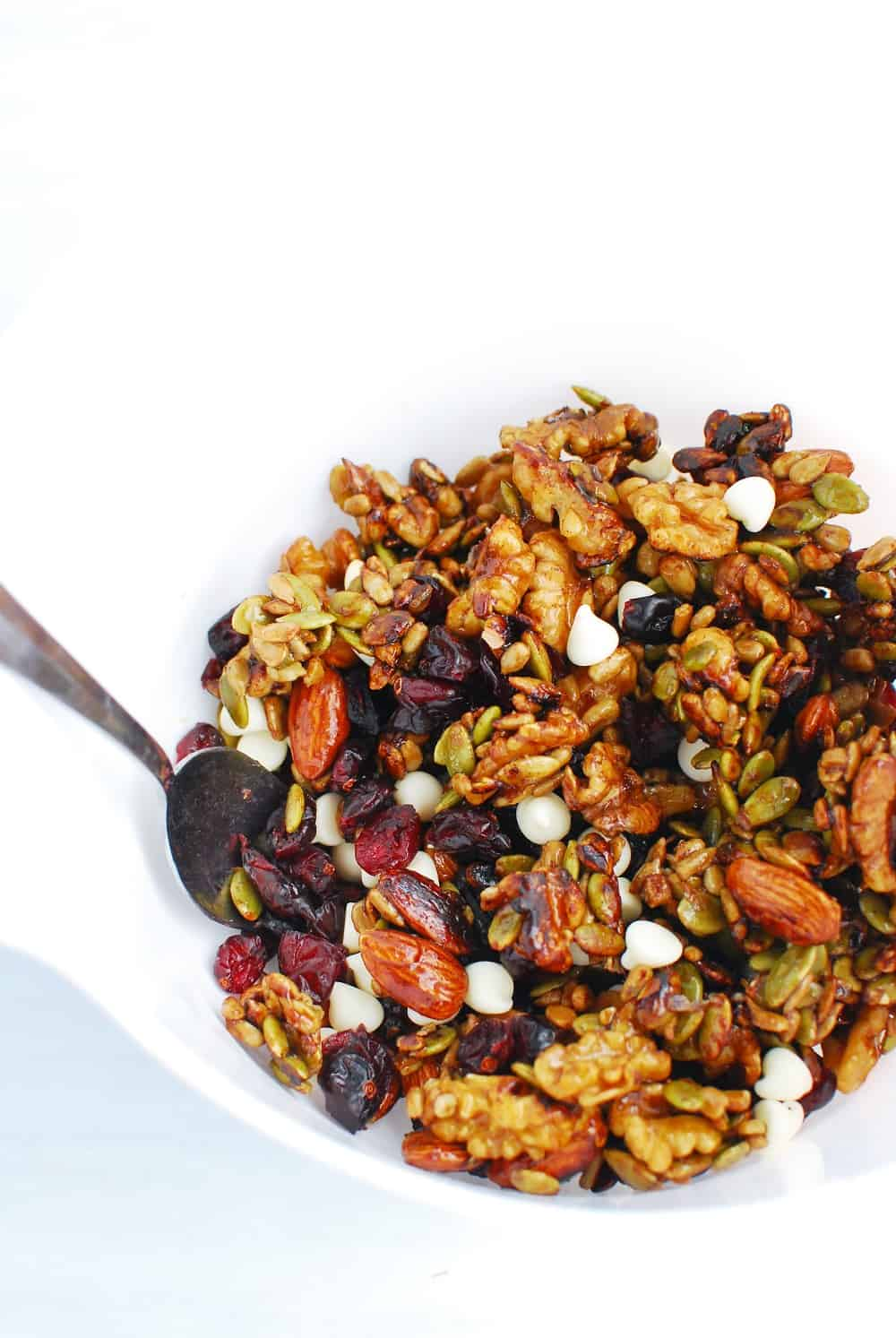 mixing up all the ingredients for fall trail mix in a bowl