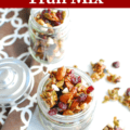 fall trail mix in a small jar next to a spoonful of trail mix