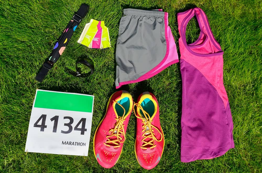 A flatlay of gear for a marathon including energy gels as a source of carbs