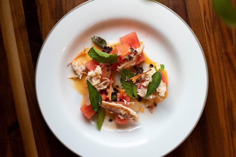 A plate of watermelon crab salad