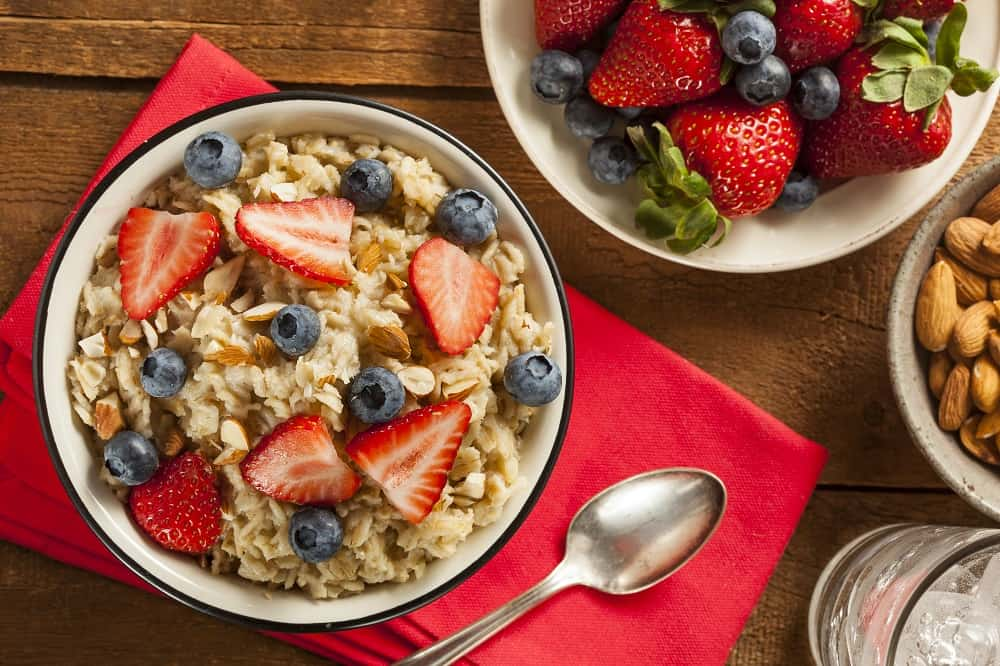 A bowl of oatmeal with berries