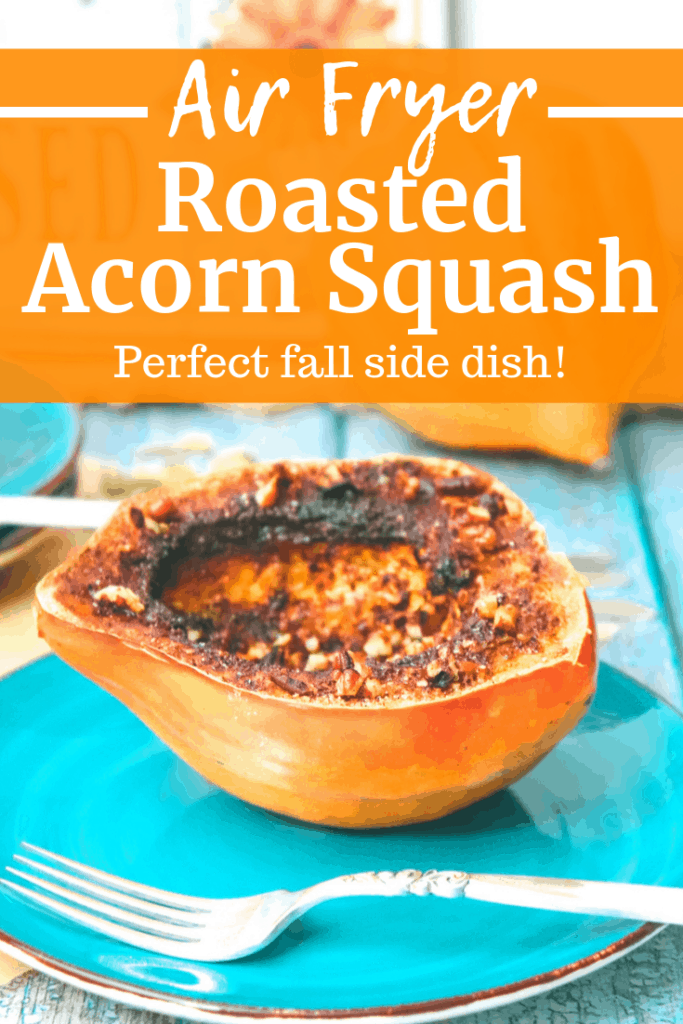 Air fryer acorn squash on a plate next to a fork