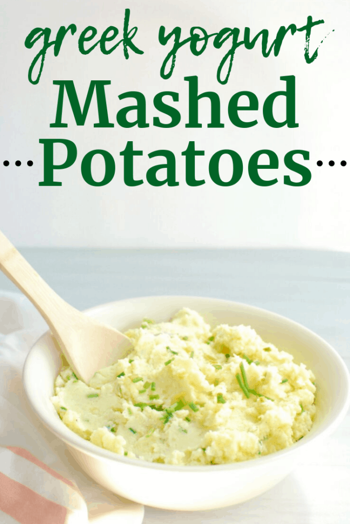 Greek yogurt mashed potatoes with chives in a serving bowl