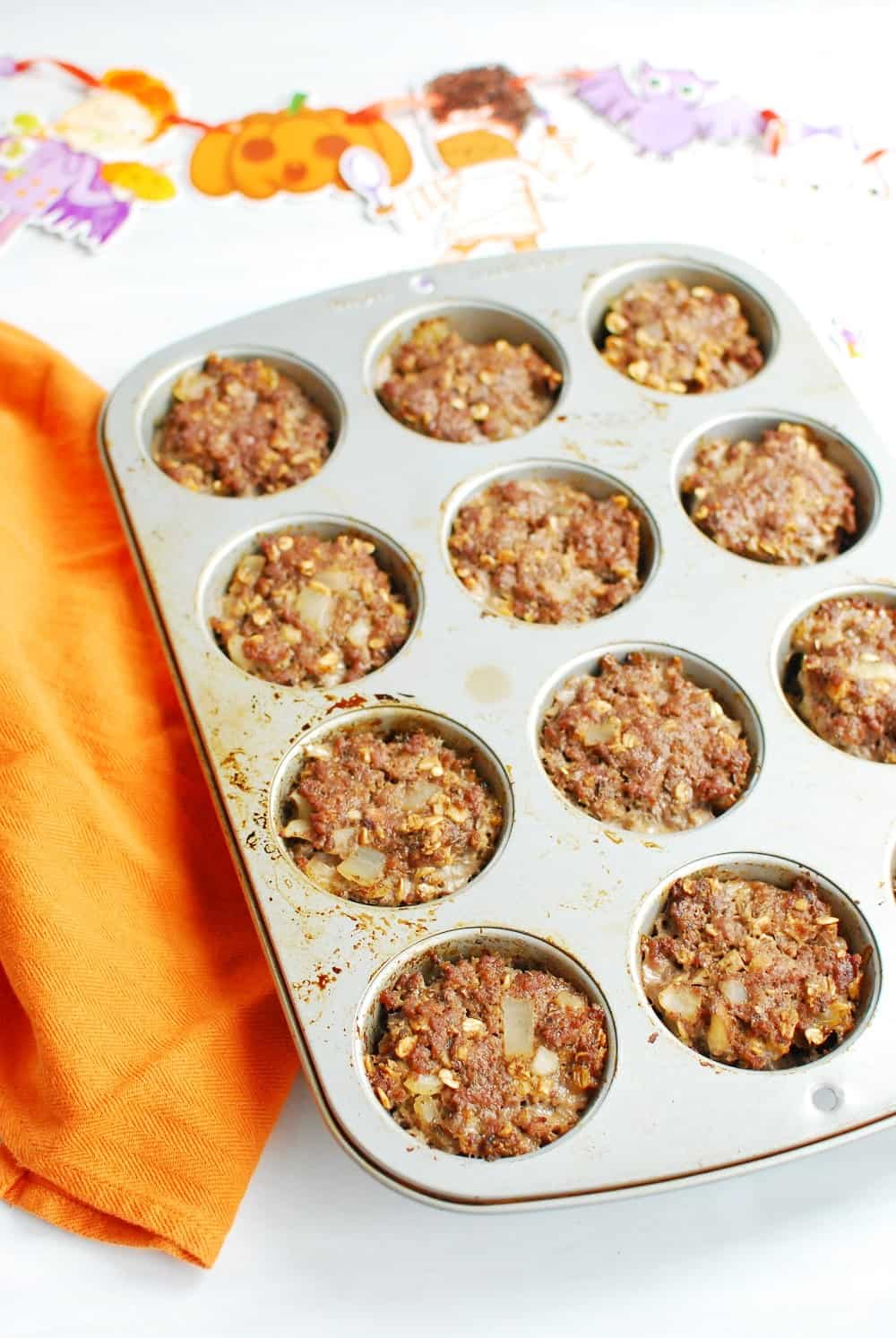 Mini meatloaves in a muffin tin after they've finished cooking