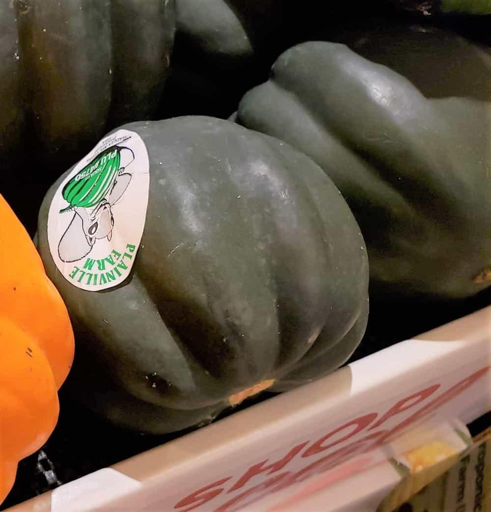 Acorn squash in a produce bin