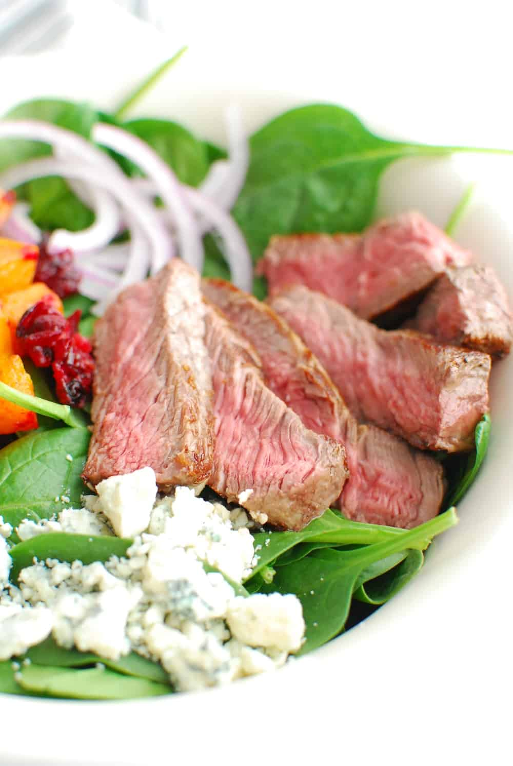 close up of the steak in a steak and blue cheese salad