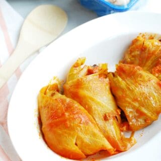 Hungarian stuffed cabbage rolls on a white dish
