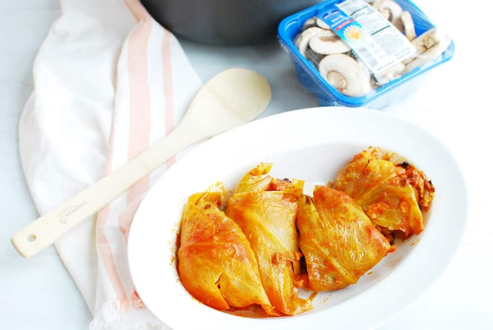 stuffed cabbage in a white platter