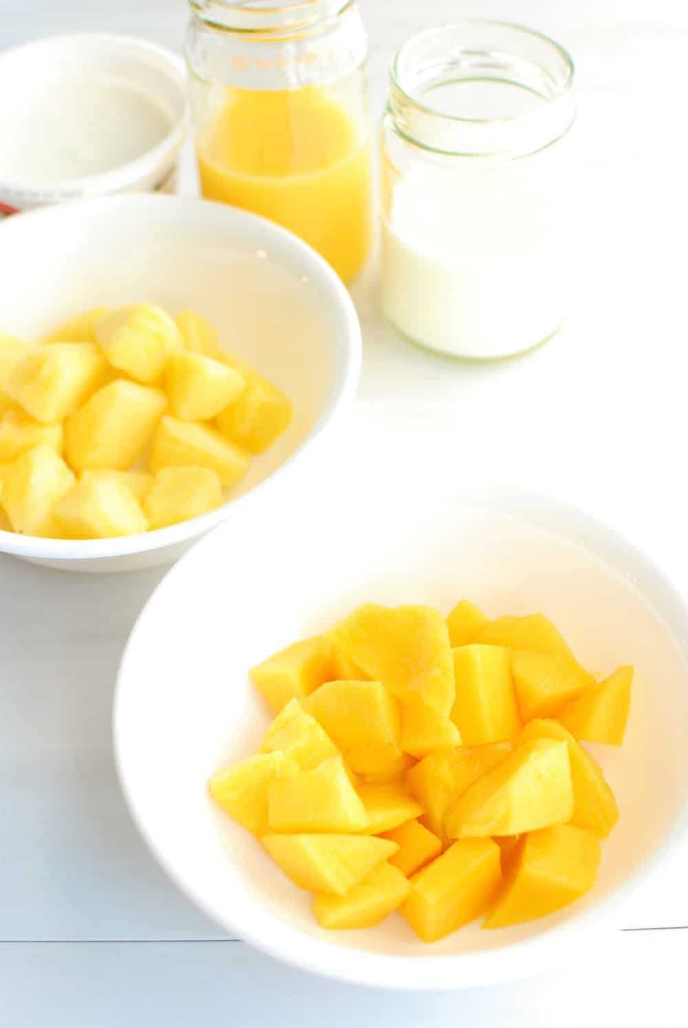 Ingredients to make a mango pineapple smoothie