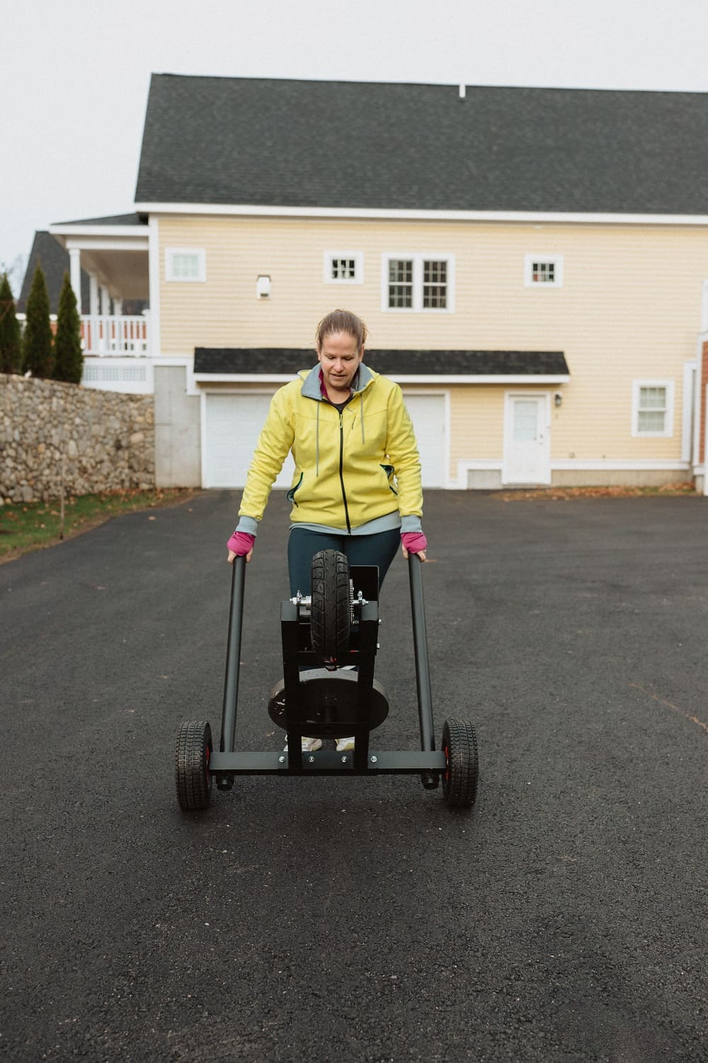 a woman wheeling the XPO trainer push sled easily