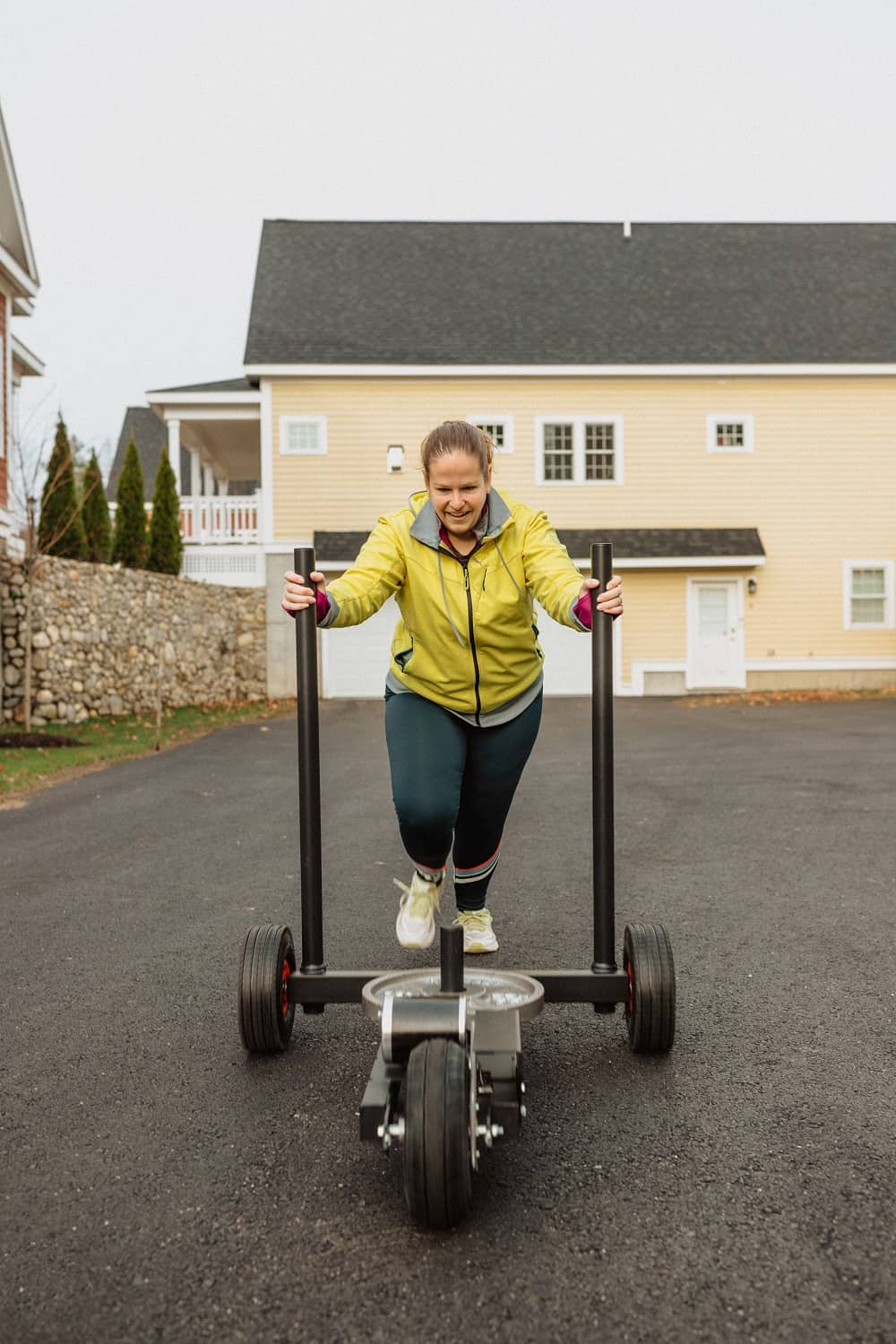 a woman doing a sled push workout