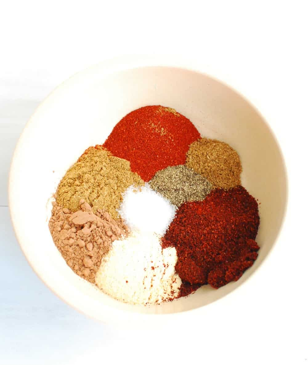 different spices in a bowl to season chili