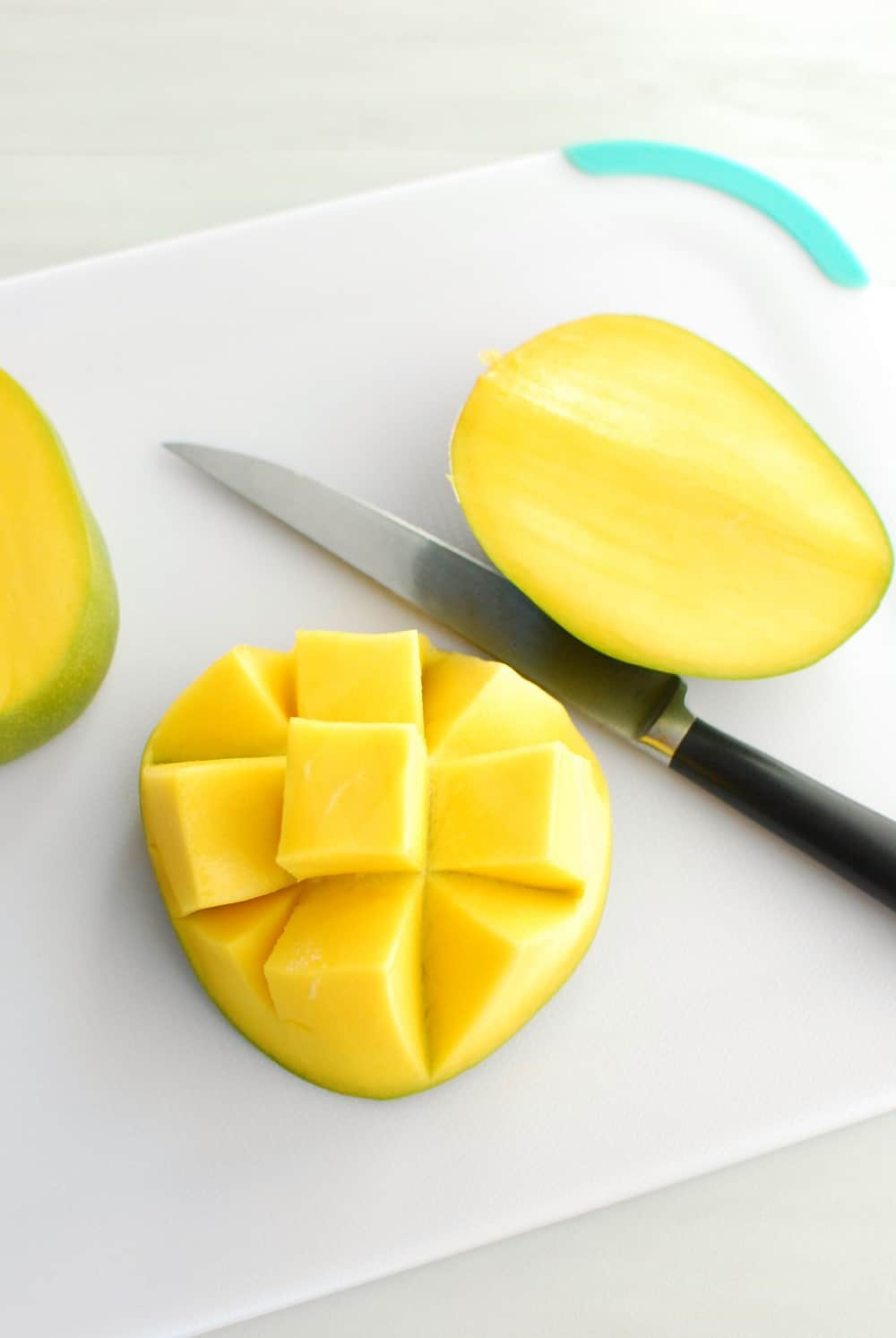 A mango cut in a checkerboard pattern