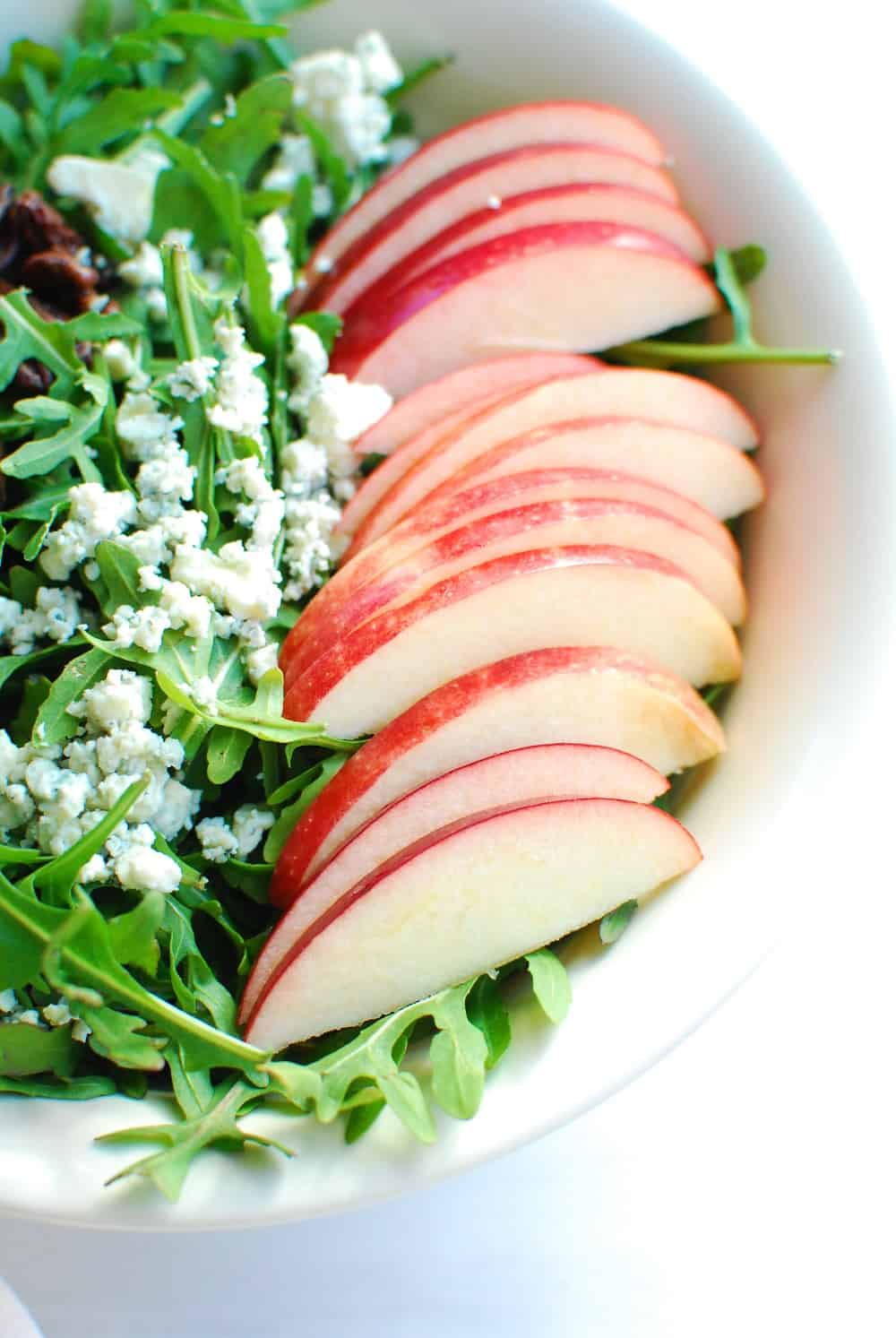 Close up of the apples in the arugula apple salad