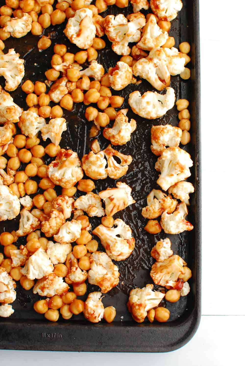 a pan full of cauliflower and chickpeas tossed in bbq sauce