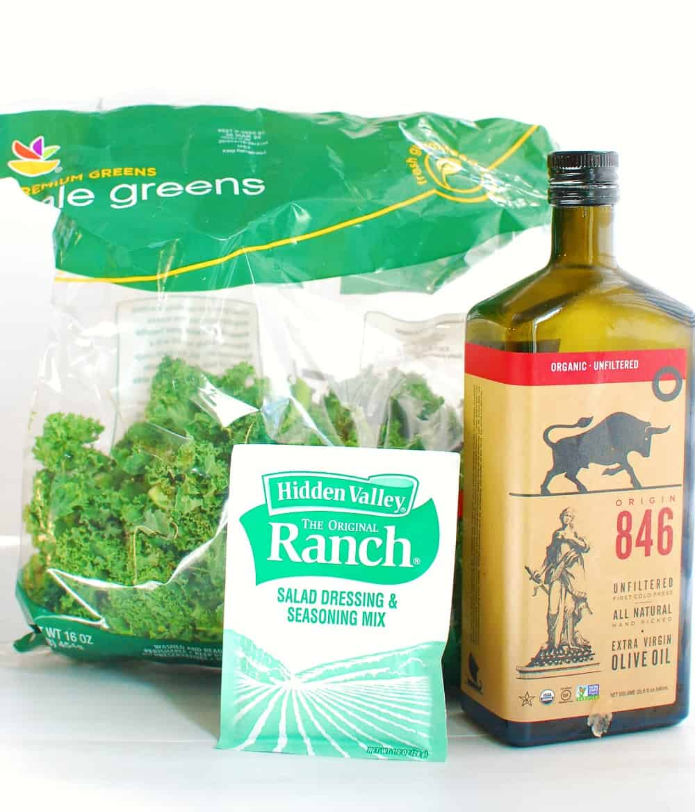 a bag of kale, a packet of ranch seasoning mix, and a bottle of olive oil