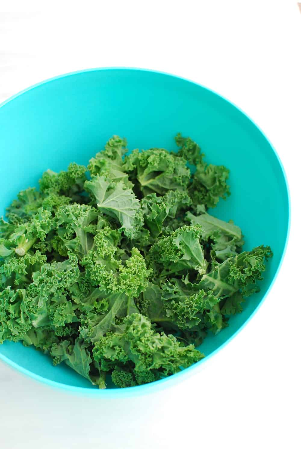 a bowl full of chopped kale