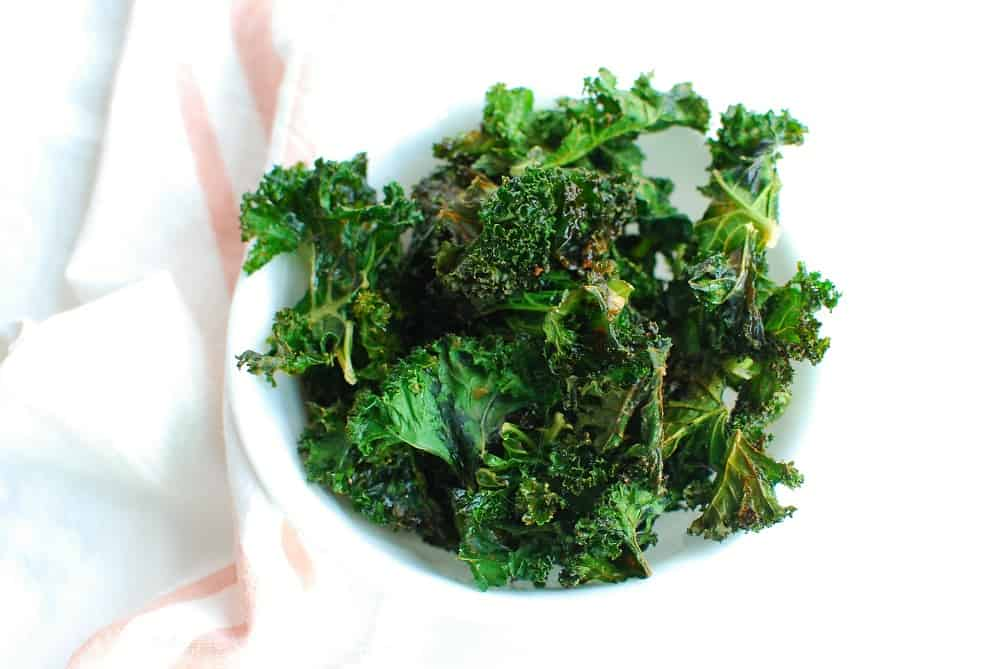 a bowl full of cooked kale chips
