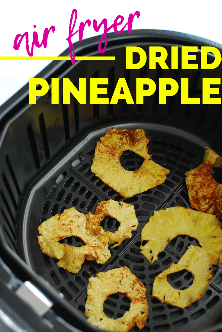 dehydrated pineapple in an air fryer basket