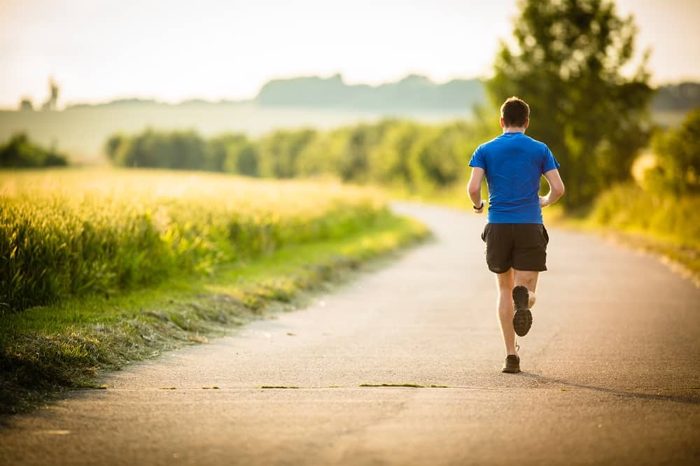 a man running outside on a sunny day