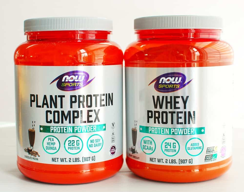 a container of whey protein powder and a container of plant protein powder