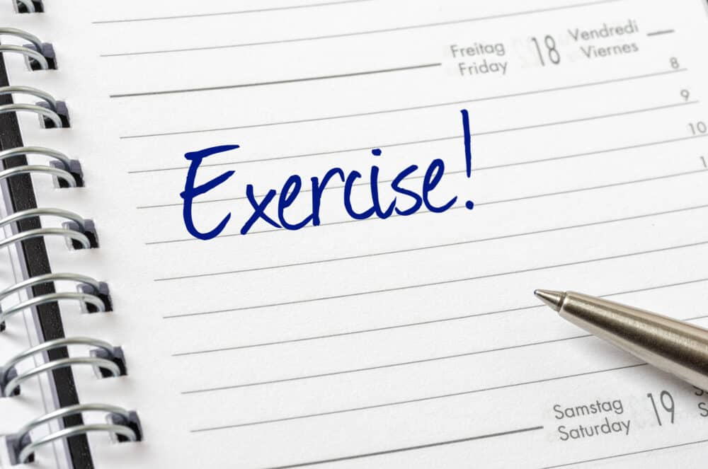 a planner with exercise scheduled into that day's tasks